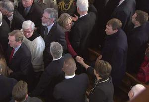 Michelle O'Neill and Arlene Foster shake hands at the funeral of Martin McGuinness. Pic BBC
