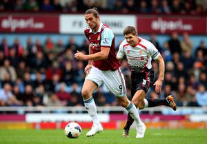 LONDON, ENGLAND - APRIL 06:  Andy Carroll of West Ham is pursued by Steven Gerrard of Liverpool during the Barclays Premier League match between West Ham United and Liverpool at Boleyn Ground on April 6, 2014 in London, England.  (Photo by Julian Finney/Getty Images)