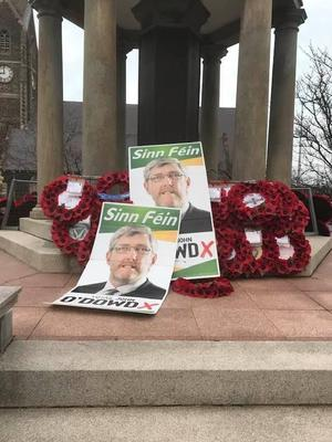 Lurgan cenotaph was attacked by vandals and had election posters dumped on it.