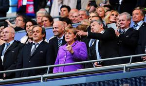 LONDON, ENGLAND - MAY 25:  (L-R) UEFA President Michel Platini, German Chancellor Angela Merkel and President of the German Footall Association Wolfgang Niersbach look on prior to the UEFA Champions League final match between Borussia Dortmund and FC Bayern Muenchen at Wembley Stadium on May 25, 2013 in London, United Kingdom.  (Photo by Alex Grimm/Getty Images)