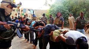 Image posted on a militant website appears to show militants from the al-Qaida-inspired Islamic State of Iraq and the Levant (ISIL) leading away captured Iraqi soldiers dressed in plain clothes after taking over a base in Tikrit, Iraq. (AP Photo via militant website)