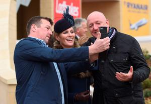 Zara Tindall poses for a selfie with racegoers on St Patrick's Day during the Cheltenham Festival at Cheltenham Racecourse. PRESS ASSOCIATION Photo. Picture date: Thursday March 12, 2015. See PA story RACING Cheltenham. Picture credit should read: Joe Giddens/PA Wire. RESTRICTIONS: Editorial Use only, commercial use is subject to prior permission from The Jockey Club/Cheltenham Racecourse. Call +44 (0)1158 447447 for further information.