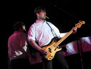 INDIO, CA - APRIL 12:  Musician Alex James of the band Blur performs onstage during day 1 of the 2013 Coachella Valley Music & Arts Festival at the Empire Polo Club on April 12, 2013 in Indio, California.  (Photo by Kevin Winter/Getty Images for Coachella)