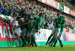Northern Ireland's Steven Davis (right, number 8) celebrates scoring his side's first goal of the match with teammates during the UEFA European Championship Qualifying match at Windsor Park, Belfast. PRESS ASSOCIATION Photo. Picture date: Thursday October 8, 2015. See PA story SOCCER N Ireland. Photo credit should read: Niall Carson/PA Wire.