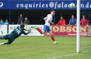 On the way: The ball heads into the net and is goal-scorer Paul Smyth set for a trip to England?
