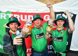 Pacemaker Press 31-07-2020: Glentoran fans Dad Gary pictured with his sons (Right)Tom and Carson(Left) its Carson's Stagg Party getting married in two weeks in the Wesbourne Glentoran Supporters club in Belfast watching Glentoran playing during Friday night's Irish Cup final against Ballymena United in Windsor Park in Belfast, Northern Ireland. Picture By: Arthur Allison/ Pacemaker Press.