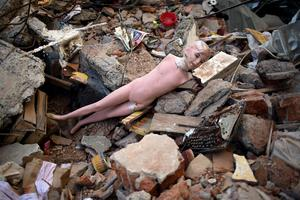 A mannequin lies amid the rubble caused by a 7.8-magnitude earthquake, in La Chorrera, Ecuador, Monday, April 18, 2016. The Saturday night quake left a trail of ruin along Ecuadors normally placid Pacific Ocean coast. At least 350 people died and thousands are homeless. President Rafael Correa said early Monday that the death toll would surely rise, and in a considerable way. (AP Photo/Rodrigo Abd)