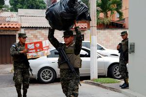 A Honduran military police officer carries donations to be sent to the quake victims in Ecuador, in Tegucigalpa on April 18, 2016. Honduras will send a group of specialists to Ecuador Monday to help in the rescue works. Rescuers and desperate families clawed through the rubble Monday to pull out survivors of an earthquake that killed 350 people and destroyed towns in a tourist area of Ecuador. / AFP PHOTO / ORLANDO SIERRAORLANDO SIERRA/AFP/Getty Images