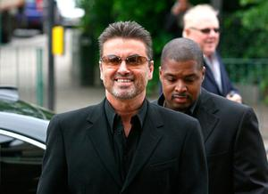 (FILES) This file photo taken on May 8, 2007 shows British pop star George Michael (L) arriving at Brent Magistrates Court in west London, as he faces charges of driving while unfit through drugs. British pop singer George Michael, who rose to fame with the band Wham! and sold more than 100 million albums in his career, has died aged 53, his publicist said on December 25, 2016. / AFP PHOTO / CHRIS YOUNGCHRIS YOUNG/AFP/Getty Images