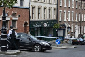 Shipquay Street in Londonderry was closed following the fatal shooting of a man in a flat above a city centre business