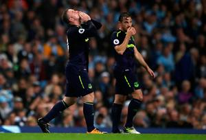 """Everton's Wayne Rooney (left) celebrates scoring his side's first goal of the game and reaching 200 Premier League goals, during the Premier League match at the Etihad Stadium, Manchester. PRESS ASSOCIATION Photo. Picture date: Monday August 21, 2017. See PA story SOCCER Man City. Photo credit should read: Nick Potts/PA Wire. RESTRICTIONS: EDITORIAL USE ONLY No use with unauthorised audio, video, data, fixture lists, club/league logos or """"live"""" services. Online in-match use limited to 75 images, no video emulation. No use in betting, games or single club/league/player publications."""