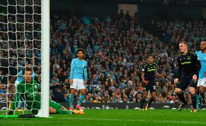Everton's English striker Wayne Rooney (R) scores his team's first goal past Manchester City's Brazilian goalkeeper Ederson (L) during the English Premier League football match between Manchester City and Everton at the Etihad Stadium in Manchester, north west England, on August 21, 2017.  / AFP PHOTO / Anthony Devlin / RESTRICTED TO EDITORIAL USE. No use with unauthorized audio, video, data, fixture lists, club/league logos or 'live' services. Online in-match use limited to 75 images, no video emulation. No use in betting, games or single club/league/player publications.  / ANTHONY DEVLIN/AFP/Getty Images