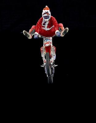 PACEMAKER, BELFAST, 11/12/2013: Santa flies! Supercross star Dan Whitby wears a Santa suit to launch the Arena Cross show which will be held in the Odyssey on January 17-18. PICTURE BY STEPHEN DAVISON