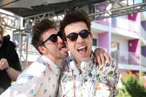 PALM SPRINGS, CA - APRIL 14:  Designer Henry Holland (L) and DJ Nick Grimshaw attend the House Of Holland eyewear pool party, hosted by Henry Holland and Io Echo, to launch the brand's new collection, in celebration of the Coachella Valley Music & Arts Festival 2013 at Saguaro Hotel on April 14, 2013 in Palm Springs, California.  (Photo by Chelsea Lauren/Getty Images for House of Holland)