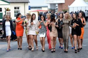 Ladies arrive during Ladies Day at the 2013 John Smith's Grand National Meeting at Aintree Racecourse, Sefton. PRESS ASSOCIATION Photo. Picture date: Friday April 5, 2013. See PA story RACING Aintree. Photo credit should read: John Giles/PA Wire