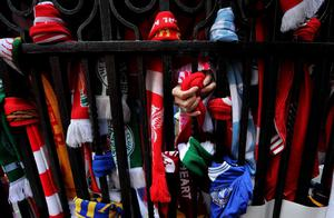 A scarf is tied to the Shankly Gates at Anfield, before the Hillsborough 25th Anniversary Memorial Service
