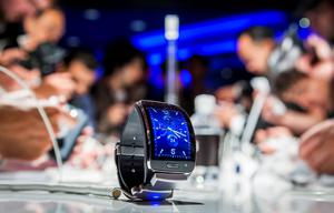 """(FILES) This picture taken on September 3, 2014 shows a Samsung Gear S, a new mobile watch device is seen during an event in Berlin ahead of the consumer electronics trade fair """"Internationale Funk Ausstellung """"(IFA). IFA, one of Europe's biggest showcases of the latest electronic gadgets, is scheduled to open on September 4 and run until September 9, 2015. AFP PHOTO / ODD ANDERSENODD ANDERSEN/AFP/Getty Images"""