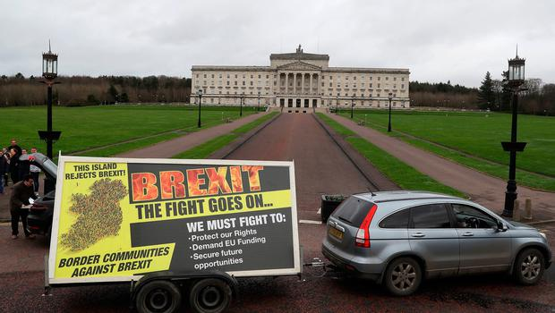 Members of Border Communities Against Brexit arrive with their new poster at Stormont in Belfast, ahead of the UK leaving the European Union at 11pm on Friday. PA Photo. Picture date: Friday January 31, 2020. See PA story POLITICS Brexit Ireland. Photo credit should read: Brian Lawless/PA Wire
