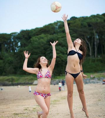 Weather picture. Helens Bay in Co.Down where temperatures soared at the weekend attracting hundreds of people to the beach. From Lisburn are 18 year olds Bronagh Walsh and Victoria Sanders. Picture Mark McCormick. 06/07/13