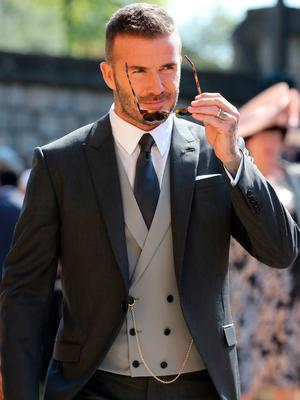 David Beckham arrives at St George's Chapel at Windsor Castle for the wedding of Meghan Markle and Prince Harry. PRESS ASSOCIATION Photo. Picture date: Saturday May 19, 2018. See PA story ROYAL Wedding. Photo credit should read: Gareth Fuller/PA Wire