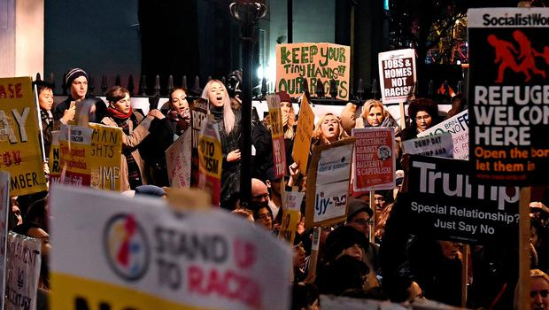People demonstrate during a protest at Downing Street in central London against US President Donald Trump's controversial travel ban on refugees and people from seven mainly-Muslim countries. Victoria Jones/PA Wire