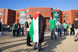 A fan wears a Palestinian flag outside the stadium before the UEFA Champions League qualifying play-off, first leg match at Celtic Park, Glasgow. PRESS ASSOCIATION Photo. Picture date: Wednesday August 17, 2016. See PA story SOCCER Celtic. Photo credit should read: Jeff Holmes/PA Wire
