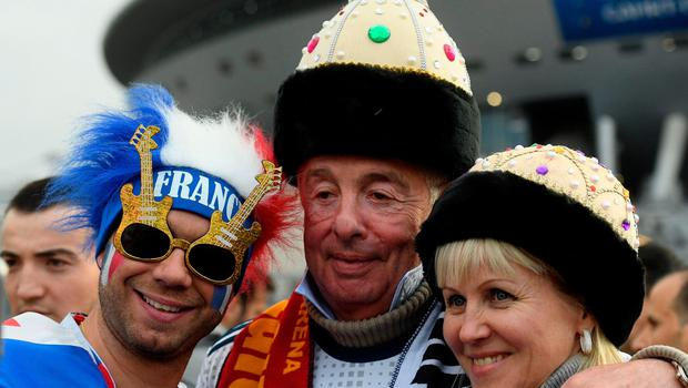 Football fans arrive at the Saint Petersburg Stadium prior to the Russia 2018 World Cup semi-final football match between France and Belgium in Saint Petersburg on July 10, 2018. / AFP PHOTO / OLGA MALTSEVA / RESTRICTED TO EDITORIAL USE - NO MOBILE PUSH ALERTS/DOWNLOADS OLGA MALTSEVA/AFP/Getty Images