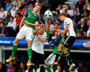PARIS, FRANCE - JUNE 21: Jonny Evans (L) of Northern Ireland and Thomas Muller (R) of Germany during the UEFA EURO 2016 Group C match between Northern Ireland and Germany at Parc des Princes on June 21, 2016 in Paris, France. (Photo by Charles McQuillan/Getty Images)