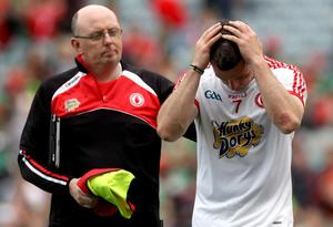 Tyrone's Conor Gormley dejected after the game