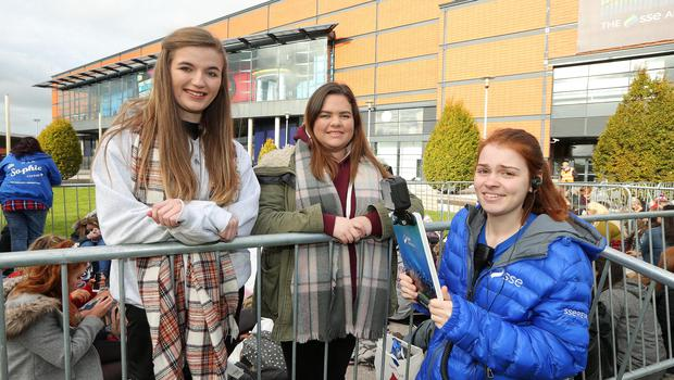 SSE Energiser Rebecca Ferris along with 1D fans  Jess Wilson and Amy Wright prepare to electrify the SSE Arena, Belfast this afternoon ahead of tonight's concert. Picture by Kelvin Boyes / Press Eye.