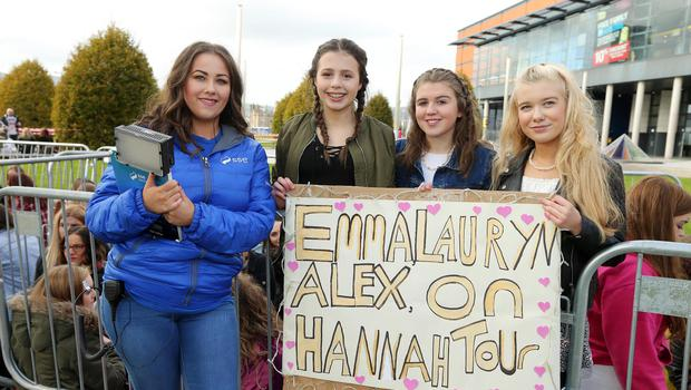 SSE Energiser Jennifer Evans along with 1D fans  Emma Armstrong, Lauren McClatchey and Hannah Monaghan prepare to electrify the SSE Arena, Belfast this afternoon ahead of tonight's concert. Picture by Kelvin Boyes / Press Eye.