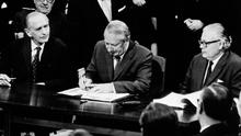 Edward Heath signs the treaty for Britain to join the European Economic Community at the Palais d'Egmont in Brussels, Belgium, in 1973