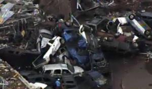 This photo provided by KFOR-TV shows a  car pile-up outside Moore, Okla., Monday, May 20, 2013. A monstrous tornado as much as a mile wide roared through the Oklahoma City suburbs Monday, flattening entire neighborhoods, setting buildings on fire and landing a direct blow on an elementary school. (AP Photo/KFOR-TV)