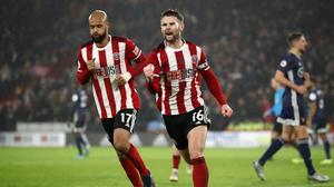 SHEFFIELD, ENGLAND - DECEMBER 26: Ollie Norwood of Sheffield United (R) celebrates after scoring his team's first goal from the penalty spot during the Premier League match between Sheffield United and Watford FC at Bramall Lane on December 26, 2019 in Sheffield, United Kingdom. (Photo by Bryn Lennon/Getty Images)