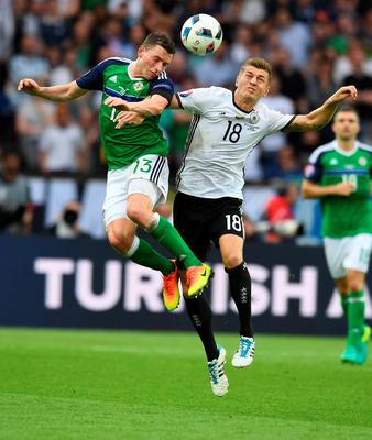 PARIS, FRANCE - JUNE 21: Corry Evans (L) of Northern Ireland and Toni Kroos (R) of Germany during the UEFA EURO 2016 Group C match between Northern Ireland and Germany at Parc des Princes on June 21, 2016 in Paris, France. (Photo by Charles McQuillan/Getty Images)