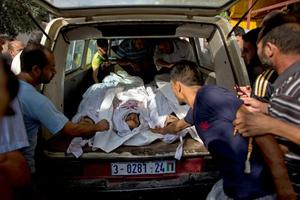 Relatives take the bodies of four Palestinians from the hospital for burial, in Beit Lahiya, Gaza Strip, Monday Aug, 4, 2014. The four were killed in an missile strike outside their homes, according to the relatives. (AP Photo/Dusan Vranic)