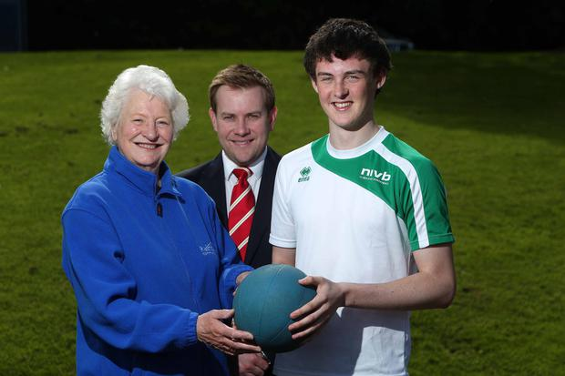 Volley good: Dame Mary Peters and Stuart Carson from Rainbow Communications congratulate Christopher Cox on receiving the Rainbow Communications Sports Award in partnership with the Mary Peters Trust