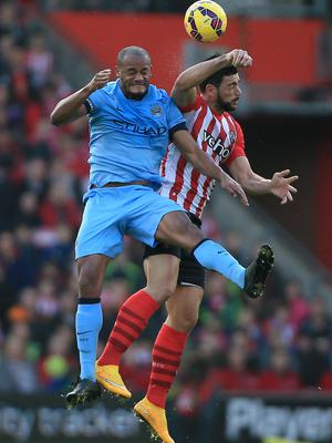 Manchester City's Vincent Kompany battles for the ball with Southampton's Graziano Pelle during the Barclays Premier League match at St Mary's Stadium, Southampton. Nick Potts/PA Wire.