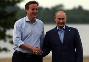 ENNISKILLEN, NORTHERN IRELAND - JUNE 17:  Russian President Vladimir Putin is greeted by Britain's Prime Minister David Cameron (L) at the official arrival of the G8 leaders at the G8 venue of Lough Erne on June 17, 2013 in Enniskillen, Northern Ireland. The two day G8 summit, hosted by UK Prime Minister David Cameron, is being held in Northern Ireland for the first time. Leaders from the G8 nations have gathered to discuss numerous topics with the situation in Syria expected to dominate the talks.  (Photo by Matt Cardy/Getty Images)