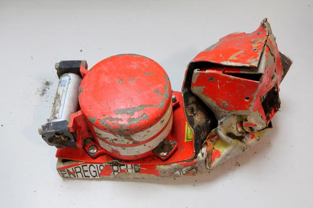 The voice data recorder of the Germanwings jetliner that crashed Tuesday in the French Alps. French investigators cracked open the badly damaged black box of a German jetliner on Wednesday and sealed off the rugged Alpine crash site where 150 people died when their plane on a flight from Barcelona, Spain to Duesseldorf slammed into a mountain. (AP Photo/Bureau d'Enquetes et d'Analyses)