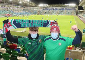 Press Eye - Belfast - Northern Ireland - 12th November 2020  European Championship 2020.  Playoff for Final Tournament - Northern Ireland Vs Slovakia at The National Stadium at Windsor Park, Belfast.  Gareth Bell and his son Caleb from Antrim   Picture by Jonathan Porter/PressEye