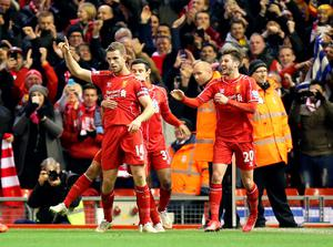 Liverpool's Jordan Henderson (no.14) celebrates scoring his sides first goal of the game