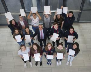 A delighted Lisneal College, Derry principal, Mr. Michael Allen with some of his A Level students last year.