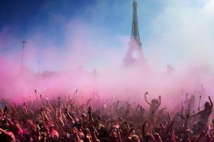 "People participate in the ""Colour Run 2015"" in Paris on April 19, 2015.  The Colour Run is a five kilometres paint race without winners nor prizes, while runners are showered with colored powder at stations along the run. AFP/Getty Images"