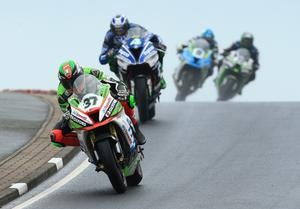 Superbike race: James Hillier (JG Speedfit Kawasaki Kawasaki) ahead of Ian Hutchinson (Tyco BMW BMW) during today's Superbike race at the North West 200.  Photo by David Maginnis/Pacemaker Press