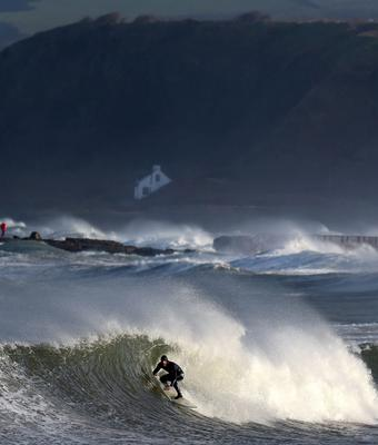 Professional surfer Al Mennie braves the conditions as he catches a wave on December 10, in Ballycastle