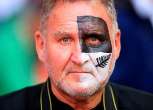 A New Zealand fan wears facepaint in the stands during the Rugby World Cup match at Wembley Stadium, London. PRESS ASSOCIATION Photo. Picture date: Sunday September 20, 2015. See PA story RUGBYU New Zealand. Photo credit should read: Mike Egerton/PA Wire. RESTRICTIONS: Editorial use only. Strictly no commercial use or association without RWCL permission. Still image use only. Use implies acceptance of Section 6 of RWC 2015 T&Cs at: http://bit.ly/1MPElTL Call +44 (0)1158 447447 for further info.