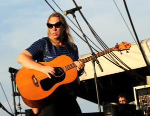 INDIO, CA - APRIL 13:  Musician Brian Ritchie of the band Violent Femmes performs onstage during day 2 of the 2013 Coachella Valley Music & Arts Festival at the Empire Polo Club on April 13, 2013 in Indio, California.  (Photo by Kevin Winter/Getty Images for Coachella)