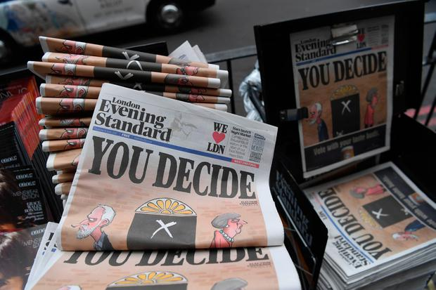 Copies of the Evening Standard newspaper, with the headline 'You decide' are pictured in central London on June 8, 2017, as Britain holds a general election. AFP/Getty Images