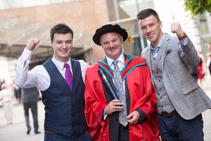 John Tommy Joe Farrell, received the honorary degree of Doctor of the University (DUniv) for distinguished services to sport at the University. John celebrates here with his son Thomas and friend Paul Sheehan. (Photo: Nigel McDowell/Ulster University)